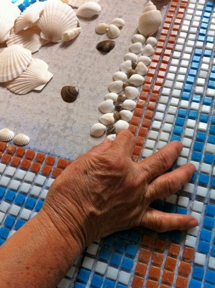 Hilda skillfully places the delicate shells