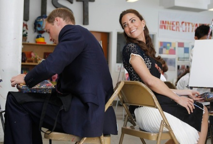 Britain's Prince William and his wife Catherine, Duchess of Cambridge, sit down to paint a mandala  (AP Photo/Alex Gallardo, Pool)