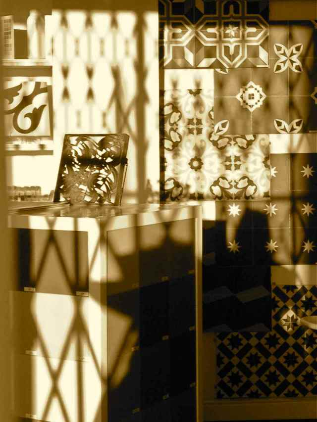 Cement tiles and shadow on Columbia Road, London