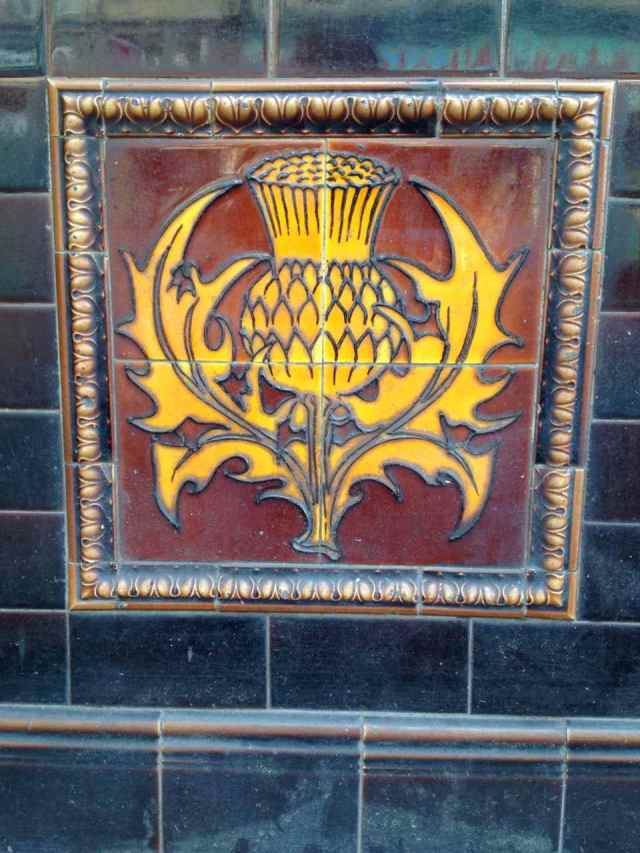 Antique thistle tile, in Brixton, London